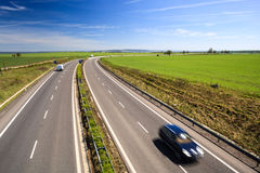 Highway traffic on a lovely summer day Stock Image