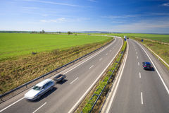 Highway traffic on a lovely summer day Royalty Free Stock Images