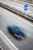 Highway traffic - motion blurred cars on a highway Royalty Free Stock Photos
