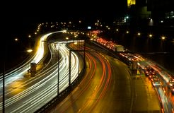 Highway traffic at night. Long time exposure was used to show car movements Royalty Free Stock Image