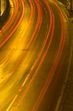 Highway traffic at night. Long time exposure was used to show car movements Royalty Free Stock Photo