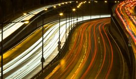 Highway traffic at night. Long time exposure was used to show car movements Stock Photography
