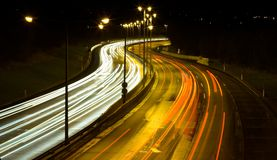 Highway traffic at night. Long time exposure was used to show car movements Stock Image