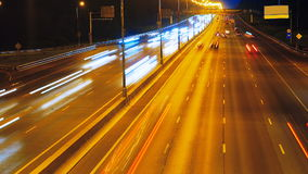 Highway traffic at night with car lights tails. Traffic on a highway at night, out of focus stock footage