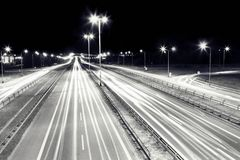 Highway traffic at night. Cars lights in motion. Royalty Free Stock Photography