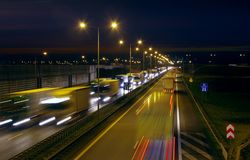 Highway traffic by night. Lots of trucks and cars on a crowded road in rush hour. Long exposure photo of highway traffic at night Stock Photo
