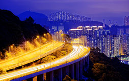 Highway traffic road to city downtown Royalty Free Stock Images