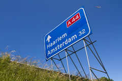 Highway traffic sign with aircraft royalty free stock image