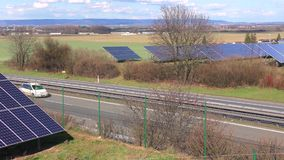 Highway traffic and solar power station time lapse speed 3,5x stock footage