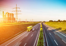 Highway traffic in sunset Royalty Free Stock Image