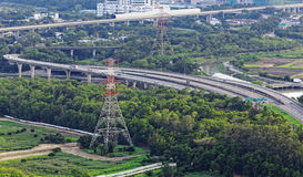Highway Traffic and transmission tower Stock Photo