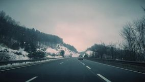 Highway traffic winter driving 4K Video. This is Highway traffic winter driving in slovenia in winter stock footage