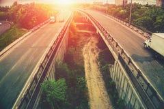 Highway tragic at sunset, big urban city bridges Royalty Free Stock Images