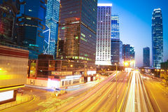 The highway trails light  on modern landmark building background Stock Images
