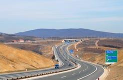 Highway transportation with cars. Near Prishtina, capital of Republic Kosovo Royalty Free Stock Photography