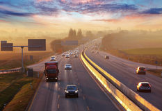 Highway transportation with cars and Truck Stock Image