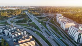 Highway transportation system highway interchange at sunset. Summer time green road way. stock images