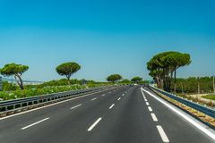 Highway with trees and blue sky in Italy Royalty Free Stock Images