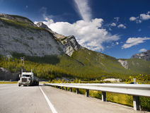 Highway and Truck in Rocky Mountains Stock Images