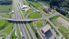 Highway with trucks and cars and gas station stock footage