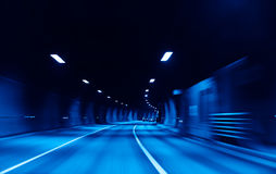Highway  tunnel. Blue highway  tunnel with cars Royalty Free Stock Photography