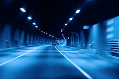 Highway tunnel. Blue highway tunnel at night Stock Images