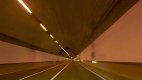 Highway Tunnel Rage Camera Car at High Speed 4k. Time lapse driving along the orange tunnel at night stock video footage