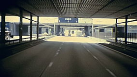 Highway tunnel to Paris. Touristic bus travelling to Paris on the highway under the tunnel bridge in France. Historic restored footage on 1976 in France stock video footage