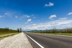 Highway under blue sky Stock Photography