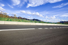 The highway. Highway, under the blue sky white clouds Stock Photography