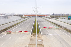 Highway under construction. Road partly ready. Stock Photo