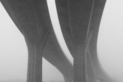 Highway viaduct in the  mist Stock Photos