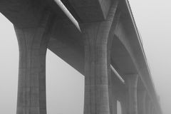 Highway viaduct in the  mist Stock Images