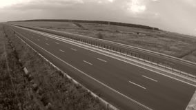 Highway from above, time-lapse. Highway, view from above, fields around, timelapse stock video footage