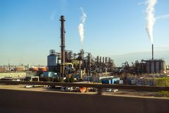 Highway view of an industrial manufacturing site royalty free stock photography