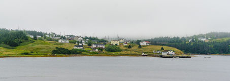 Highway view of small town in coastal Newfoundland, Canada. Stock Image