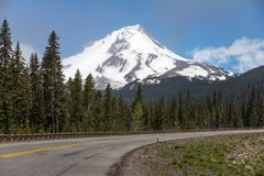 Highway 35 views of mighty Mount Hood, Oregon. Highway 35 in Oregon curves in the foreground as the road passes by an unobstructed view of glacier-capped Mount stock photos