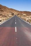 Highway through volcanic land Royalty Free Stock Photos