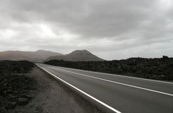 Highway in volcanic landscape. Highway through volcanic landscape on Lanzarote Royalty Free Stock Photography