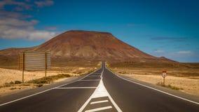 Highway through volcanic landscape. Leading towards extinct volcano Stock Photo