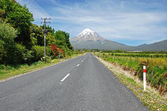 Highway with volcano in the background Stock Photography