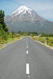 Highway with volcano in the background Royalty Free Stock Images