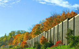Highway Wall. The wall on the side of a US highway during fall time Stock Images