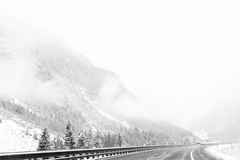 Highway whiteout in the mountains Royalty Free Stock Image