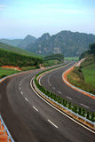 Winding Highway. Wide view of winding highway around green mountain and blue sky, Shanxi Province, China Stock Photo