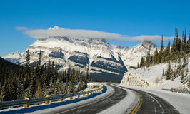 Highway in Winter through mountains Stock Photo