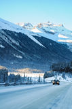 Highway in Winter through mountains Stock Images