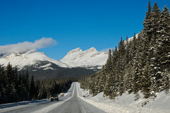 Highway in Winter through mountains Royalty Free Stock Photography