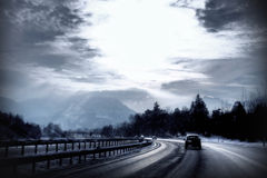 Highway in winter with snow and a cold day light. A moment this winter along the highway from Salzburg to Munich, a cold day with clear light and a weak sun and stock photos