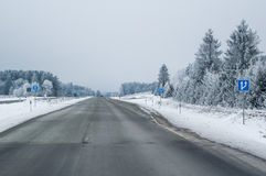 Highway in the winter, trees covered with hoarfrost Stock Photos